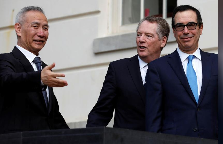 U.S. Treasury Secretary Steve Mnuchin (R) and Trade Representative Robert Lighthizer welcome China's Vice Premier Liu He before two countries trade negotiations in Washington, U.S., October 10, 2019