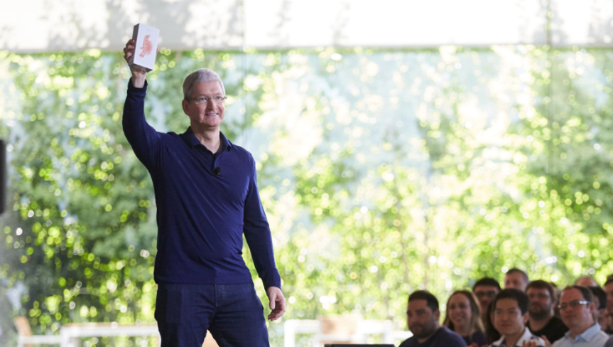 Ceo Tim Cook Holds Up The Billionth Iphone
